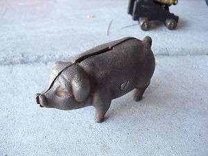 Antique Cast Iron Penny Piggy Bank 2 1/4 Tall LOOK