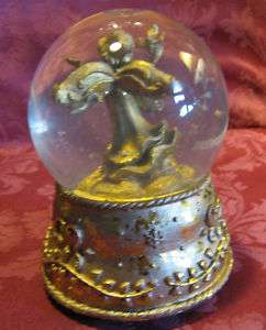 Golden Angel Musical Snow Globe plays Santa Claus Is Co