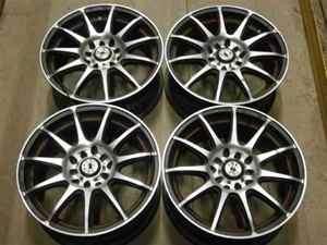 Set of 4 Aftermarket 15x61/2 Konig Wheels 5 lug 100mm